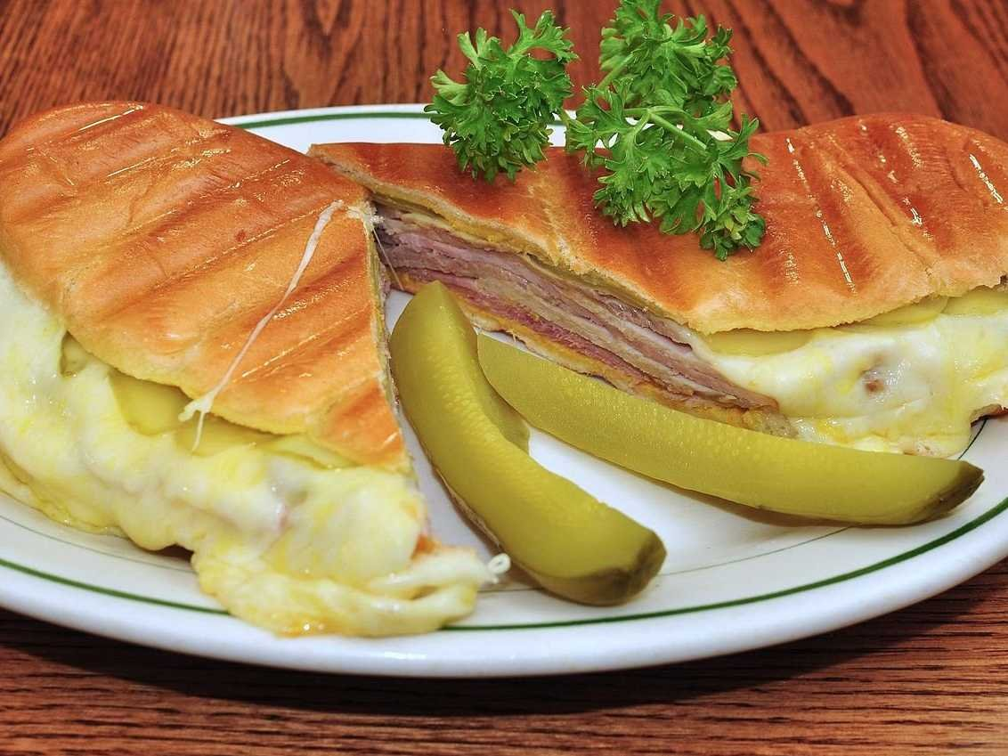 florida-the-sunshine-state-is-known-for-its-cuban-sandwich-with-generous-portions-of-ham-roasted-pork-swiss-cheese-pickles-and-mustard-all-on-two-slices-of-cuban-bread